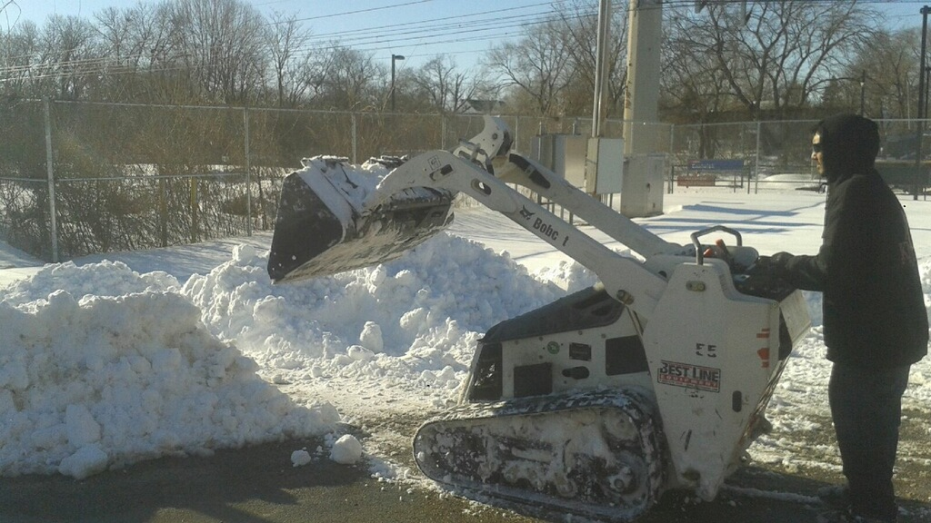 SEPTA employees clear snow.