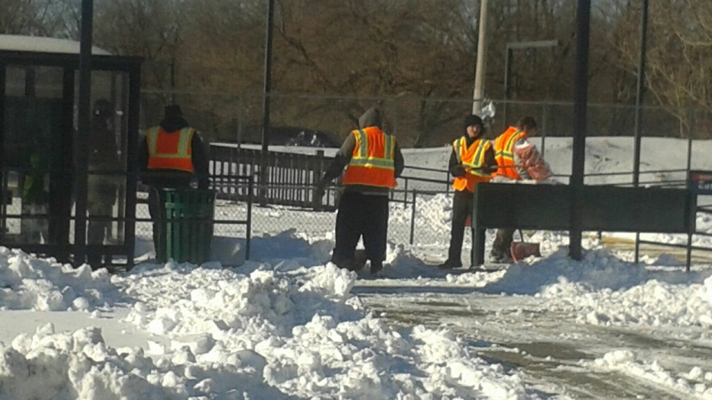 SEPTA employees work to clear snow.