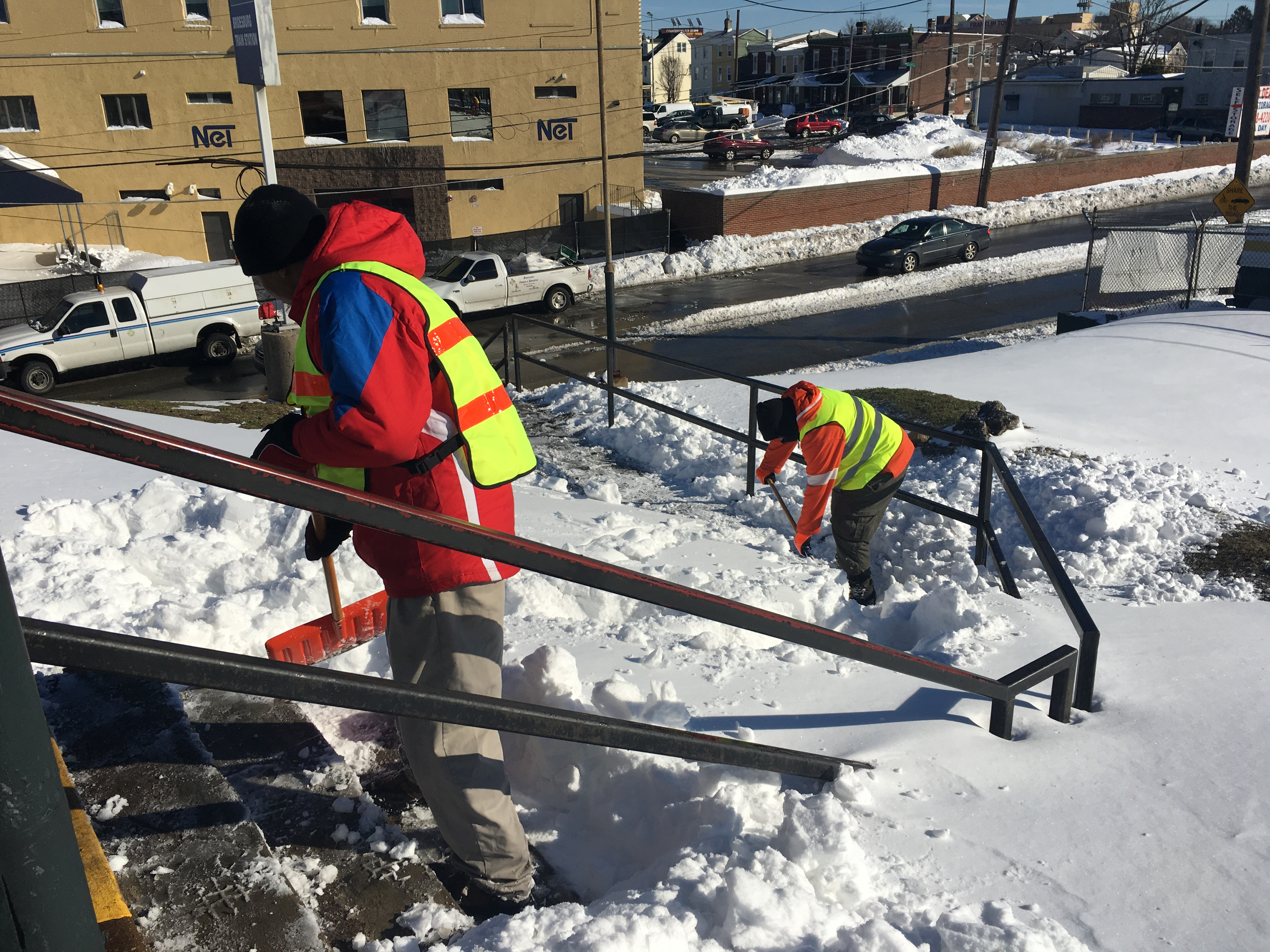 SEPTA employees with the Engineering, Maintenance, and Construction Department clear snow from the steps at Bridesburg Station on the Trenton Line Monday, January 25, 2016.
